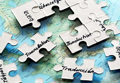puzzle pieces with translation written in different languages